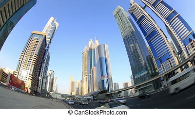 city traffic in Dubai - city traffic with skyscraper in...