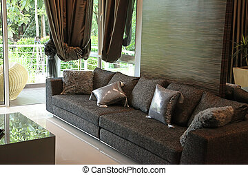 Modern stylish sofa in with elegant cushions