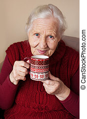 Elderly woman with cup of tea - Elderly woman with cup of...