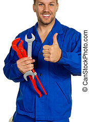 handyman with tool - a worker in an industrial enterprise...
