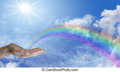 Sending Rainbow Healing - Male hand palm up with a rainbow...