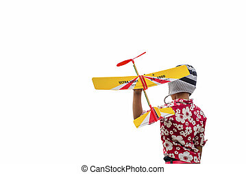 Boy in Knitting hats playing with a toy airplane isolated on whi
