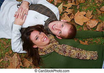 Autumn Couples - Young couple in an autumn forest picnic...