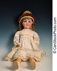 Baby doll - Well-dressed baby doll on the dark background