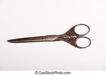 Antique scissors - Antique metal scissors on the white...