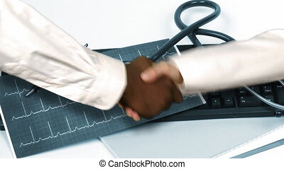 Animation of a handshake against a hospital office.