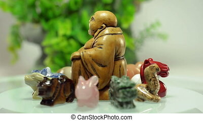 Rotating Buddha with animals - Handmade carved Buddha...