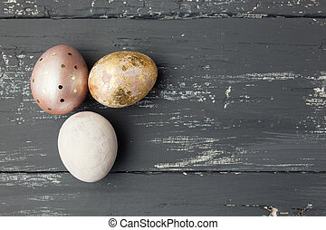 Easter eggs on wooden table Holiday background