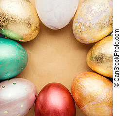 Easter eggs on wooden table with blank paper for text....