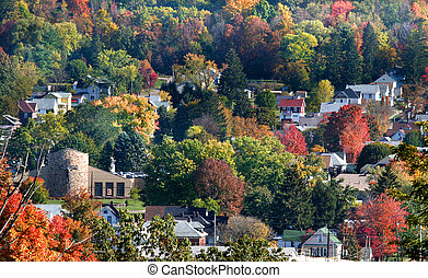 Small Town - Small town in between the colorful trees on a...