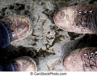 Muddy walking boots