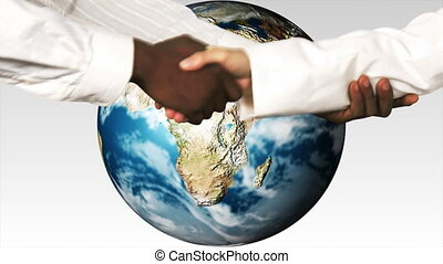 Business people shaking hands against the world.