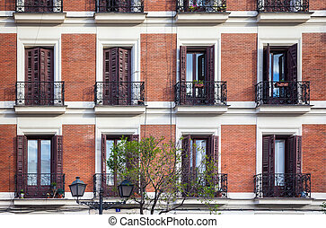 Typical building facade on a spring day in Madrid, Spain
