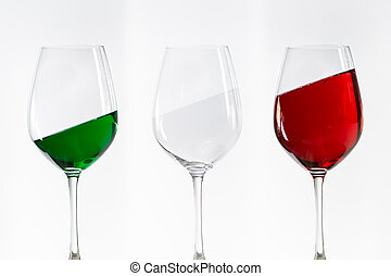three wine glasses filled with the colors of the italy flag