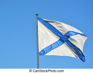 Ensign of Imperial Russian Navy against blue sky