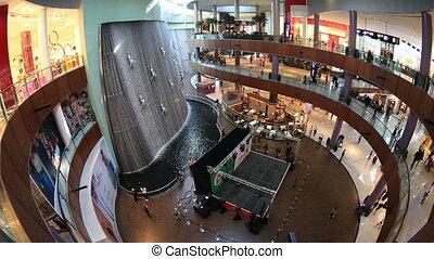 The Dubai Mall - people shopping in Dubai Mall at United...