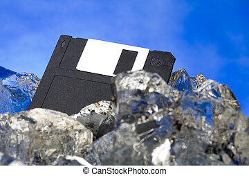 Diskette frozen in ice block in studio