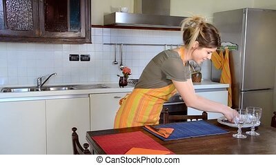 young and cute housewife - Beautiful young woman is setting...