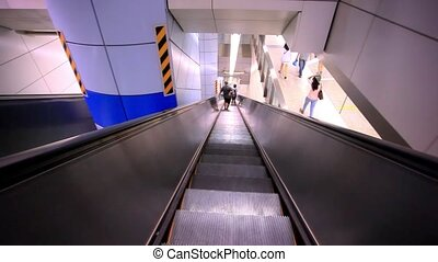 The escalator moving with man. - The escalator moving with...
