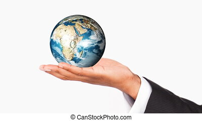 Human hand holding the Earth Planet World protection