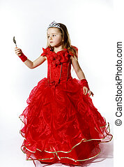 Cute little princess dressed in red isolated on white...