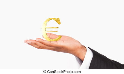 Human hand holding a Euro symbol. Concept of good economy
