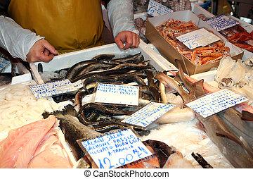 fishmonger sells the fresh fish at th