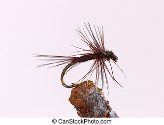 Black tiny fly fishing lure - Macro shot of a black tiny dry...