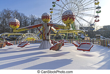 Snow-covered attractions in winter park. Sokolniki park,...
