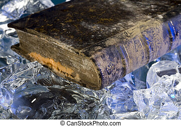 Old book damaged by water during floods on frozen ice