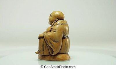 Rotating Buddha with coconut - Handmade carved Buddha...