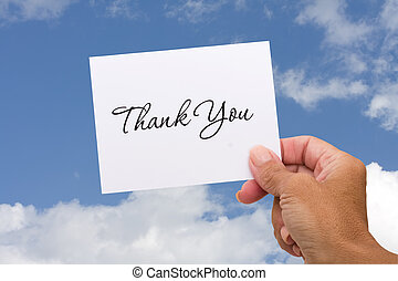 Thank you Card - A thank you card sitting in hands on a sky...
