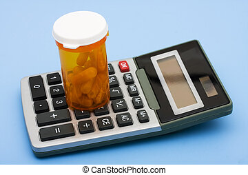 Calculating Healthcare Costs - A calculator and pills on a...