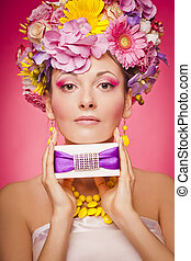 Woman with gift box and flowers hair - Skin and makeup cream...