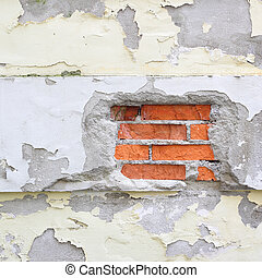 Old damaged wall with plaster and facade peeling off