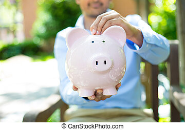 Piggy bank savings outside - Closeup portrait, young...