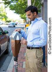 Paying the parking meter - Closeup portrait, young man...