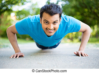 Pushup contest - Closeup portrait, young healthy handsome...