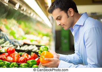 Grocery shopping - Closeup portrait, handsome young man in...
