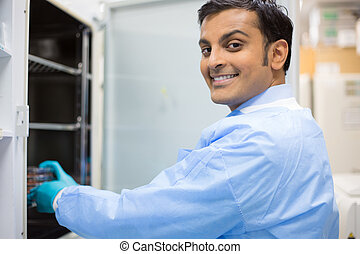 Smiling lab technician - Closeup portrait, smiling young lab...