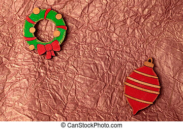 Handmade painting wood christmas decoration on gold crumpled...