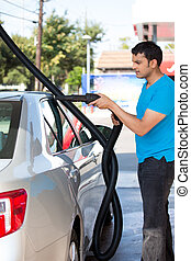Drying the car - Closeup portrait, young man driver in blue...