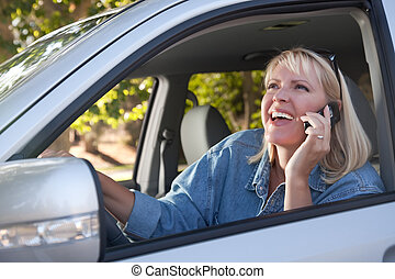 Attractive Woman Using Cell Phone While Driving