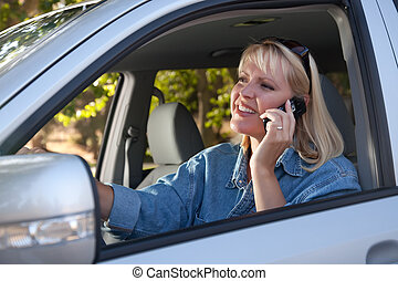 Attractive Woman Using Cell Phone While Driving - Attractive...