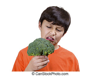 Young boy with broccoli