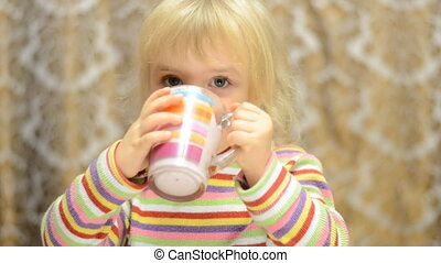 Little girl drinks emotionally and sign thumb up - Little...