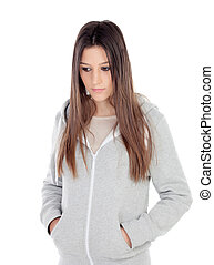 Sad teenager girl with gray sweatshirt isolated on white...