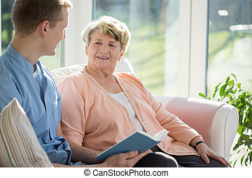 Spending time together - Young male therapist spending time...