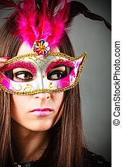 Woman in carnival mask.
