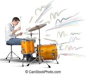 Drummer producing notes - A drummer plays his instrument...